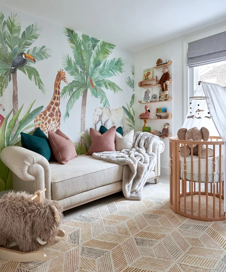 A child's bedroom with wall mural depicting wild animals in a savannah