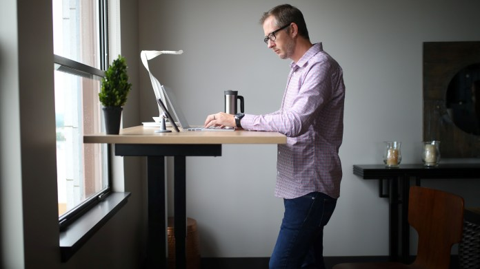 Man working at a desk standing