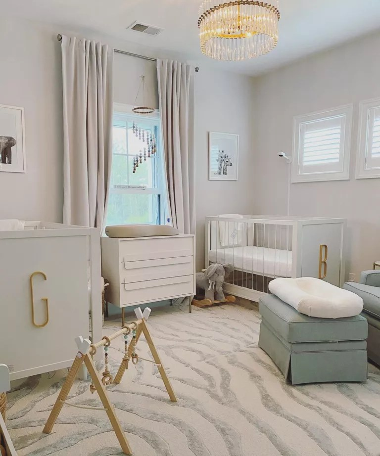 Cream twin nursery design idea by Brittany Geffert with tiger striped rug