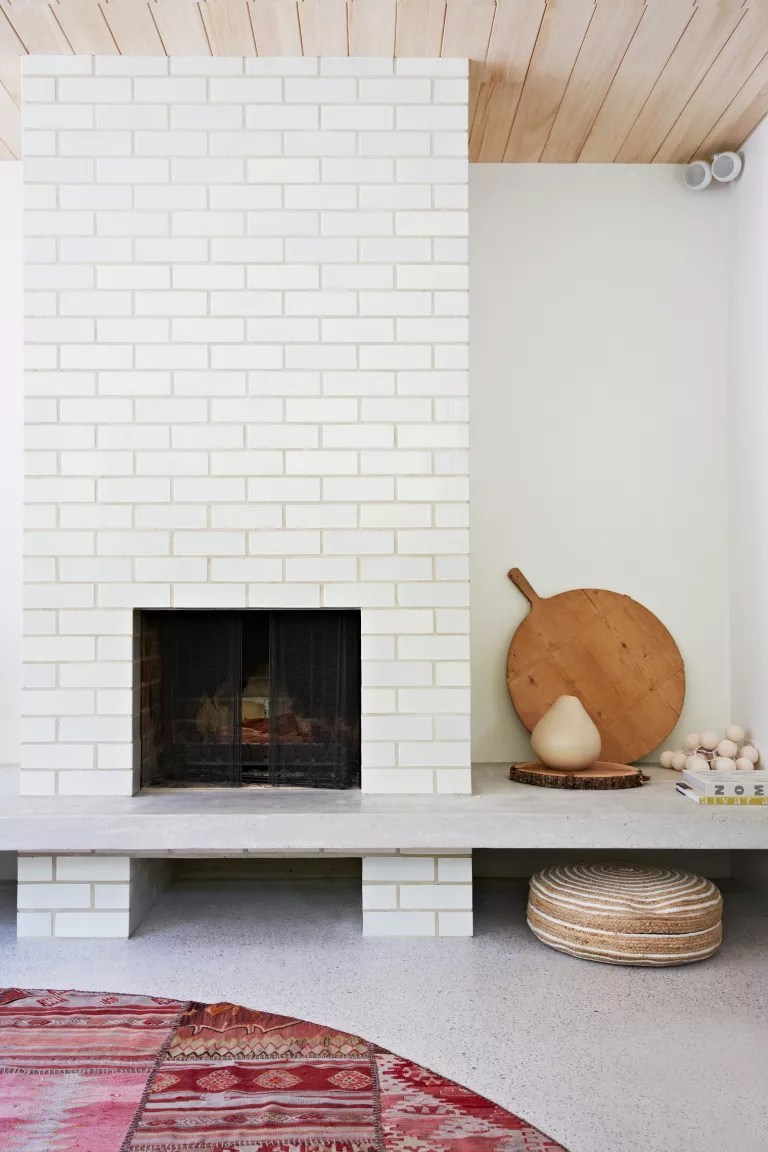 White tiled fireplace in rustic living room