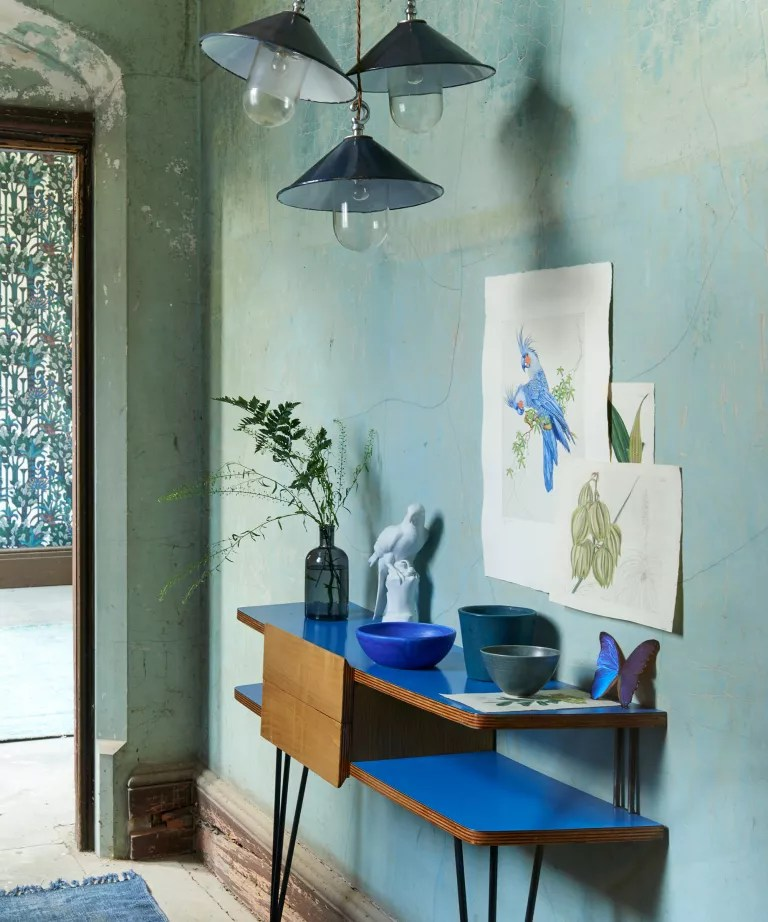 Hallway with turquoise wall and blue console