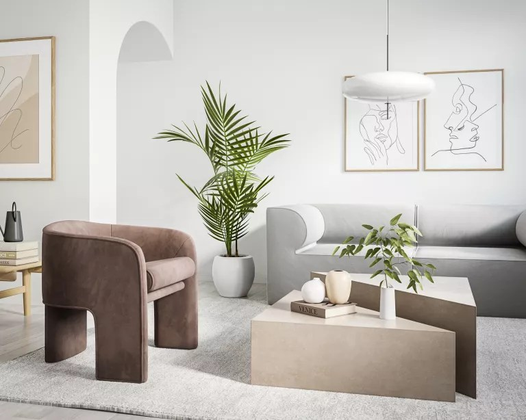 A living room with grey sofa, brown armchair, geometric beige coffee table