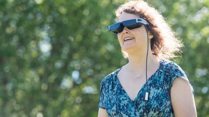 Photo of woman wearing Oxsight VR headset