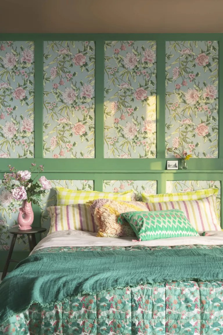 green bedroom with traditional wallpaper