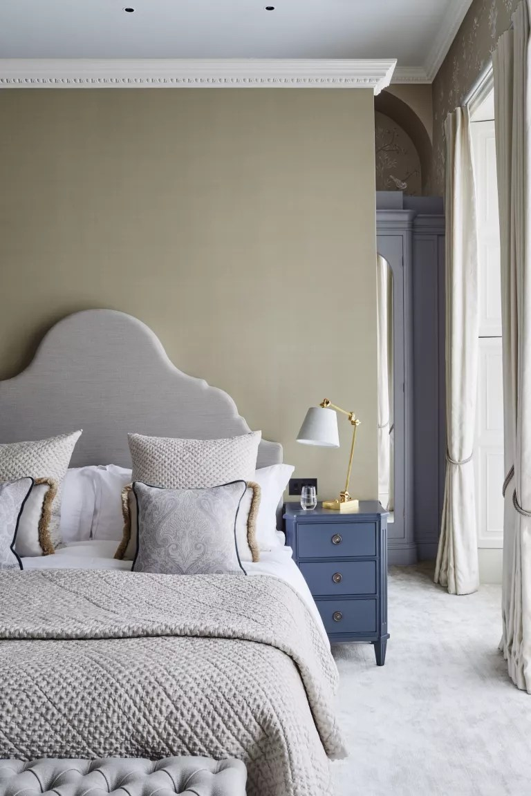 neutral masculine bedroom with grey and blue furnishings by Sims Hilditch