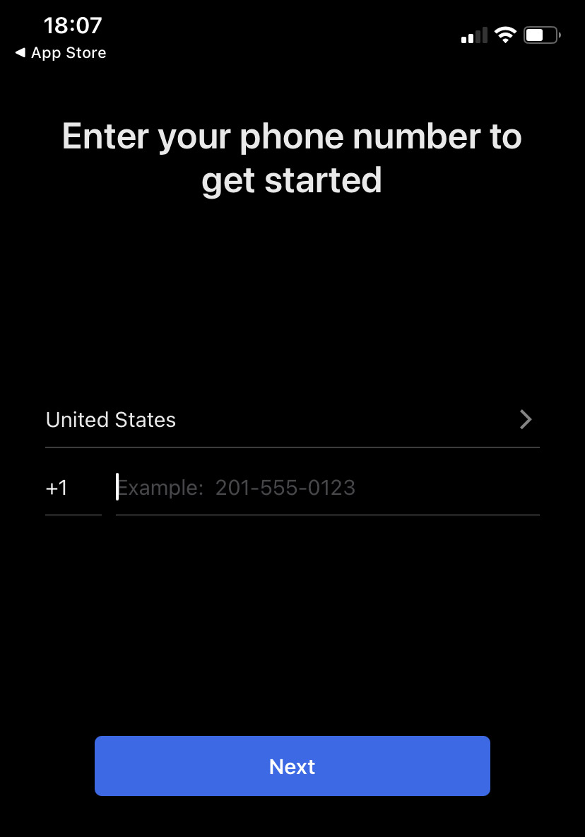 A screenshot of the phone number entry page in the Signal iOS app.