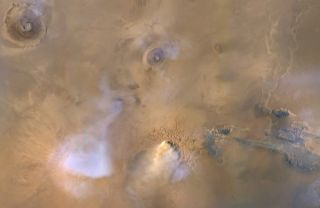 The yellow-white cloud at the bottom center of this image is a