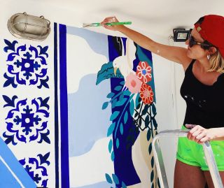Anna painting a mural