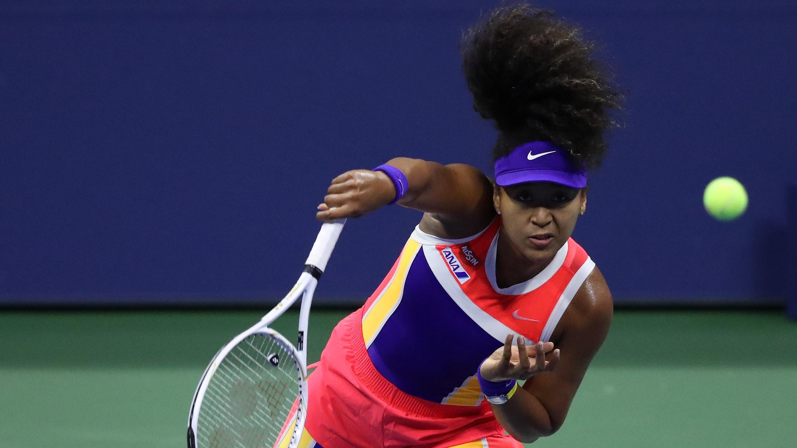Naomi Osaka playing tennis at the US Open