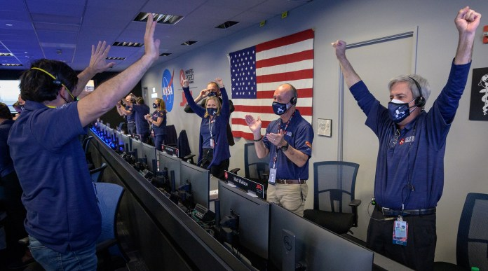 Members of NASA's Perseverance rover team react in mission control after receiving confirmation the spacecraft successfully touched down on Mars, Thursday, Feb. 18, 2021, at NASA's Jet Propulsion Laboratory in Pasadena, California.