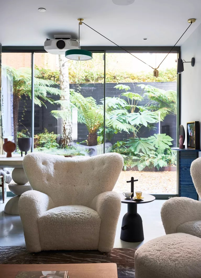 Open plan living room with outlook onto small patio garden