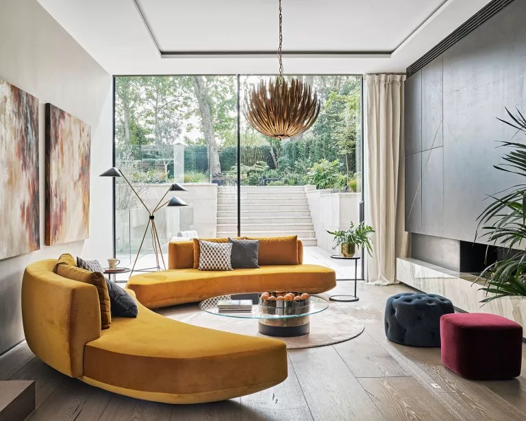 Living room with orange curved sofa
