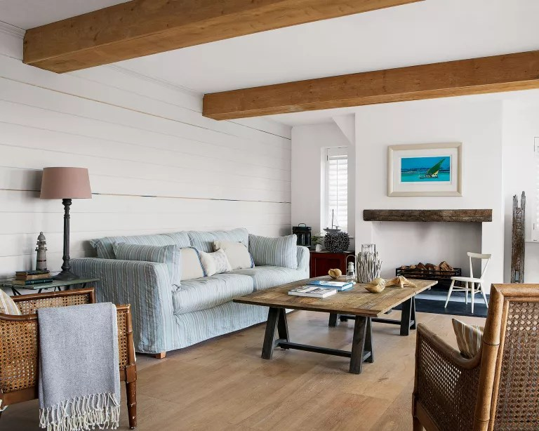 Living room with wood floor, walls and beams