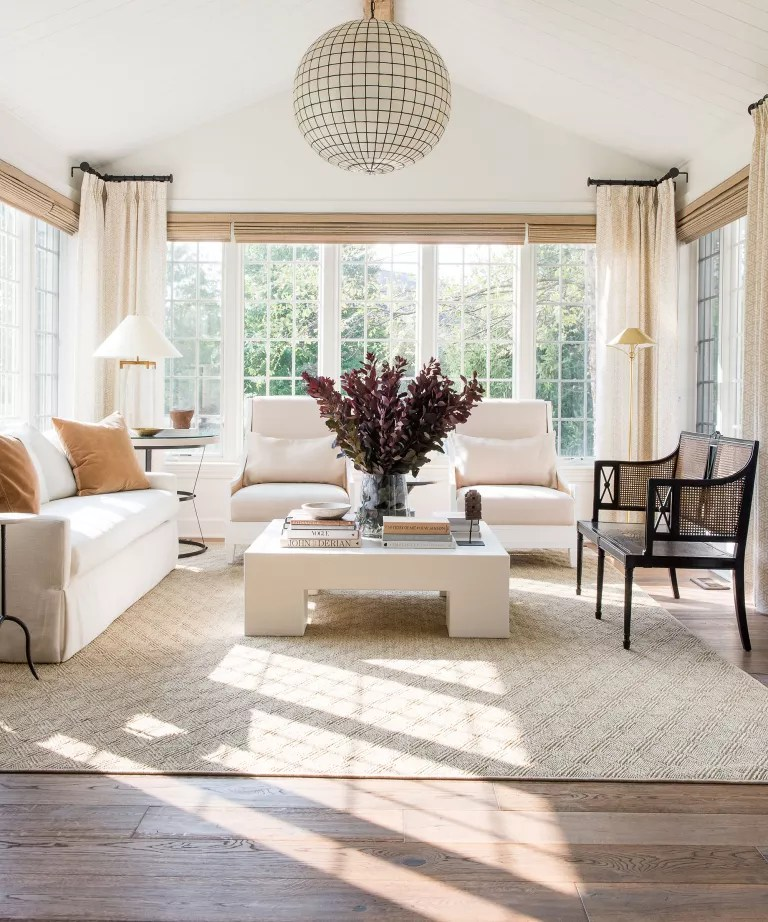 Long living room with cream interiors