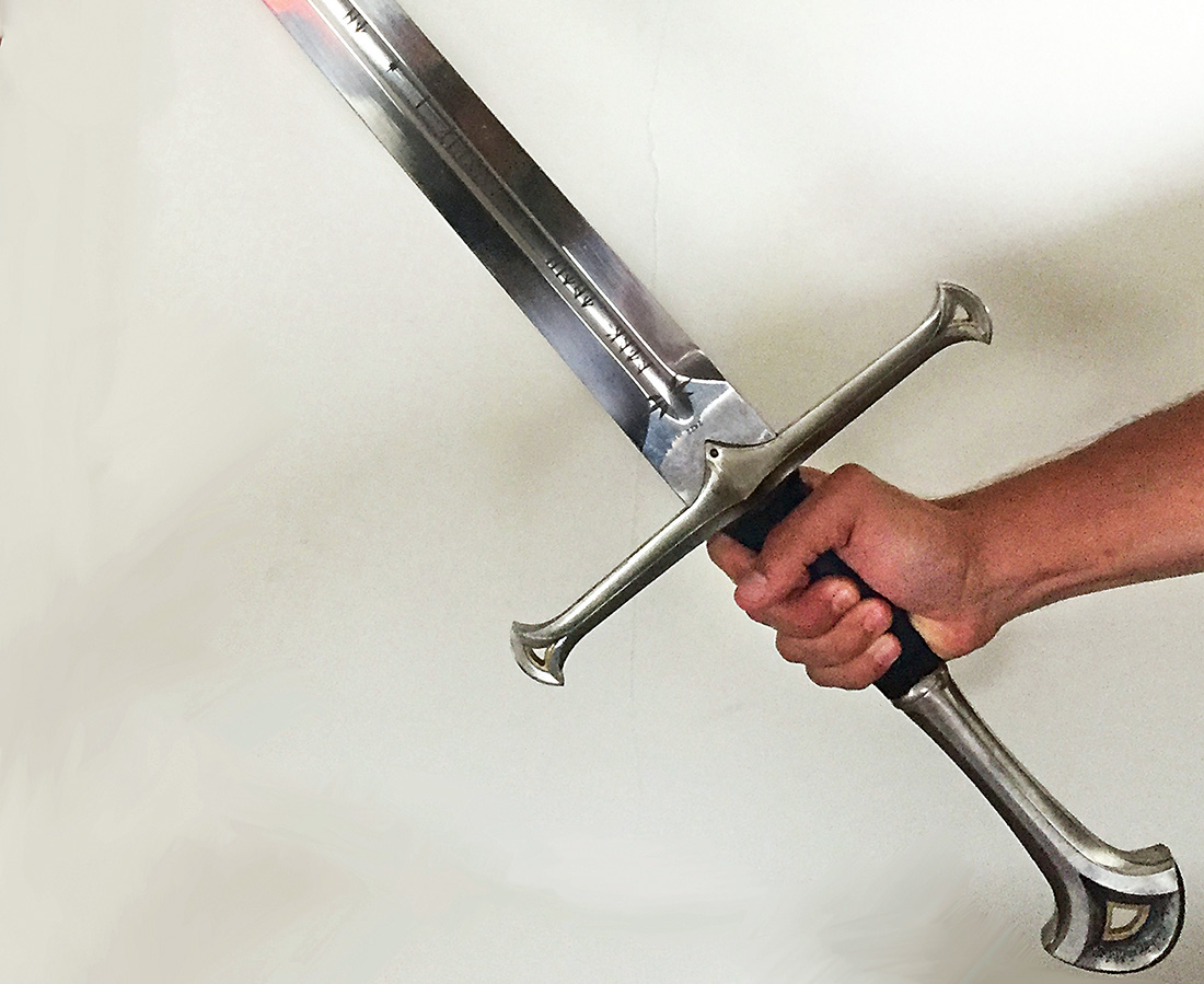 A photo of a hand holding a sword