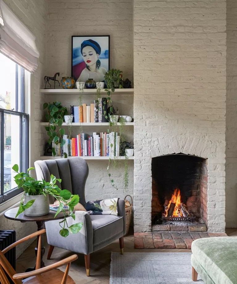 Scandinavian living room with brick wall and house plants