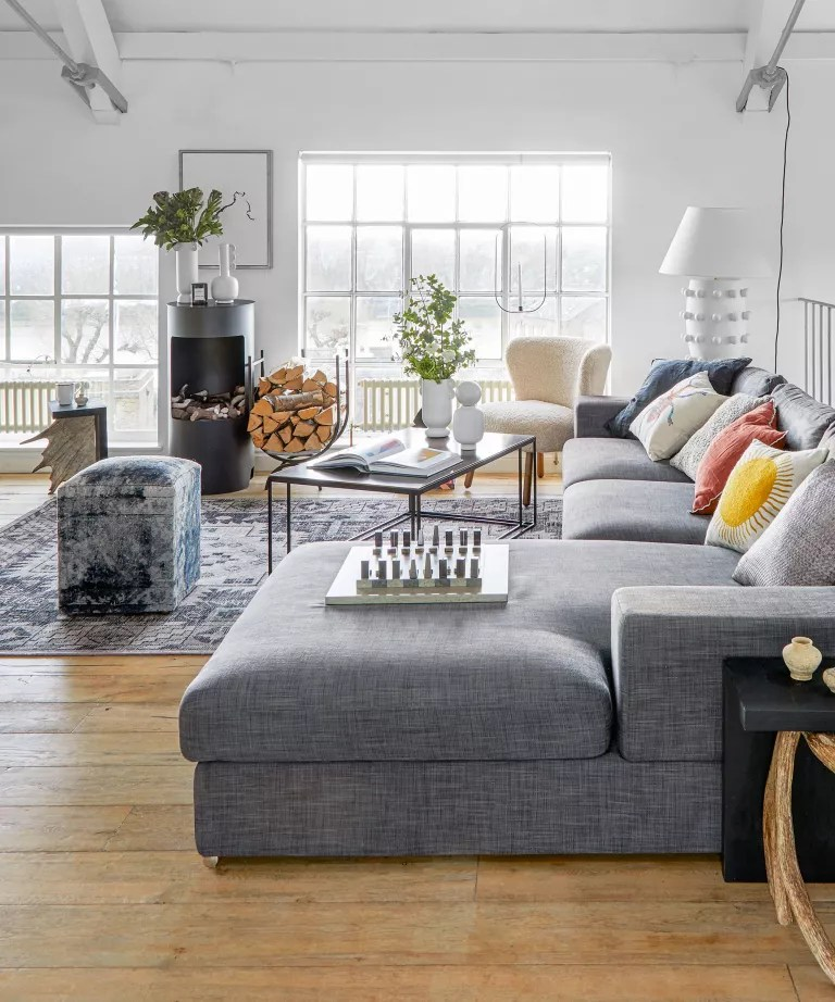 Open plan living room with white walls and l-shaped sofa