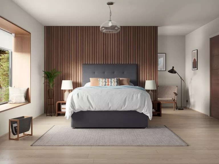 wood paneled bedroom wall with white bed