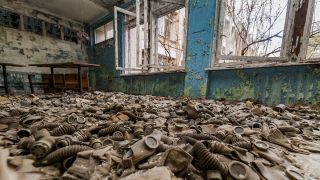 In an abandoned school in the city of Pripyat, Ukraine, the floor is littered with gas masks that were distributed after the Chernobyl disaster.