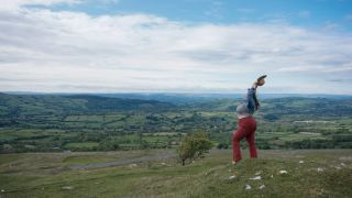 weight loss Beautiful woman holding her arms in the air, Black Mountains, Powys, Snowdonia, Wales, UK.