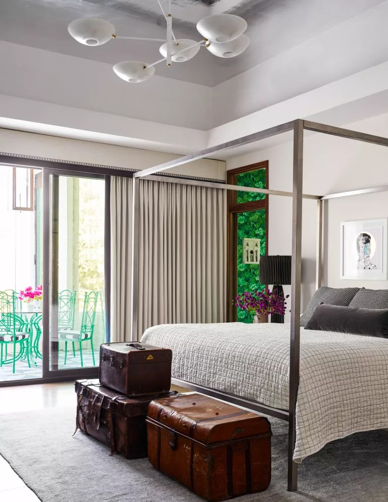 Bedroom ideas for men with four poster bed and vintage suitcases
