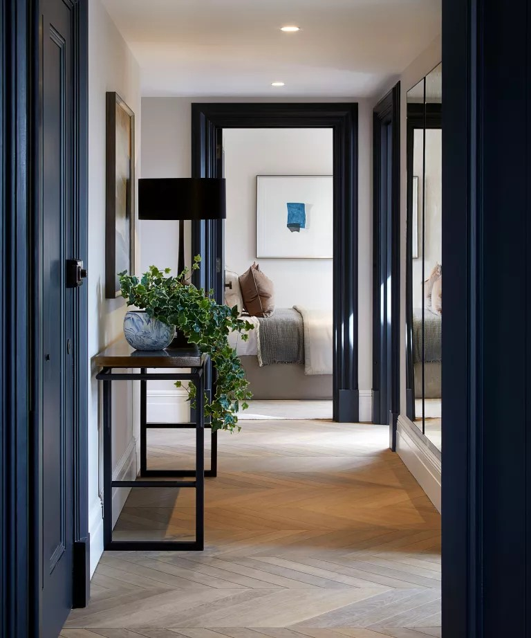Dark blue paintwork in a hallway with console table