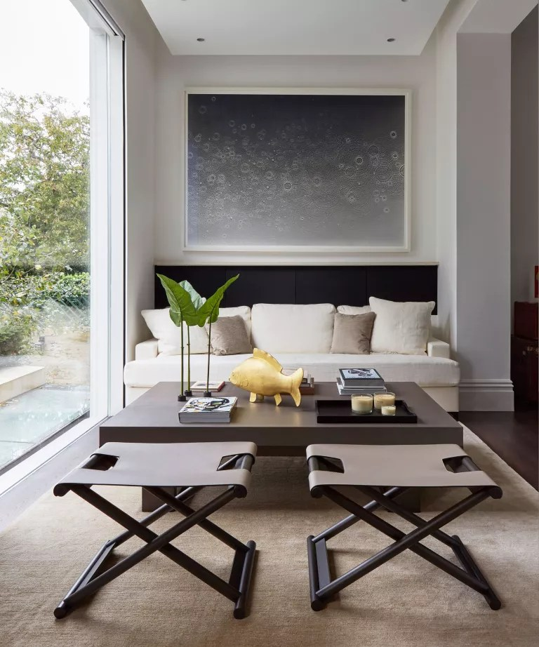 Brown living room with white walls and artwork