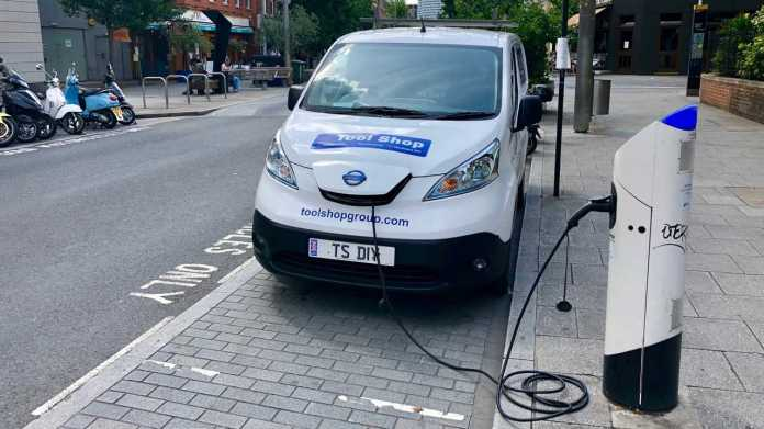 Commerical electric vehicle van uses a charging station in London