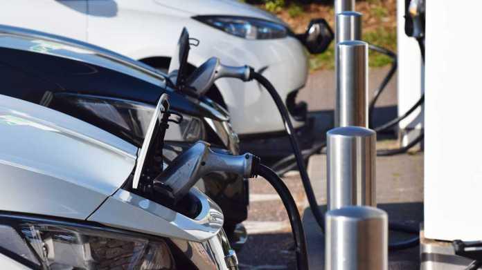 Electric cars charging at British motorway service station in Devon UK