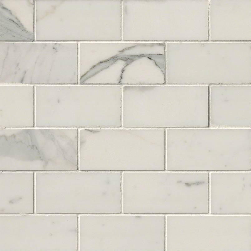 calacatta gold subway tile marble