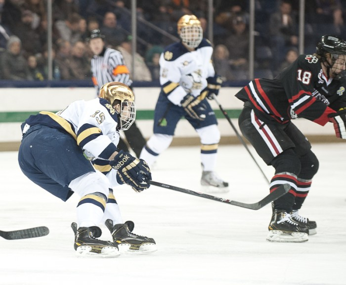 Irish junior right wing Peter Schneider pursues the puck during Notre Dame's 4-0 loss to Northeastern on Friday.