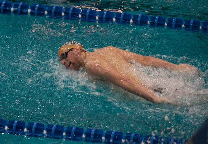 Junior Brennan Jacobsen swims against Wisconsin on Nov. 16. Jacobsen placed third in the 1,000-yard freestyle against Louisville.