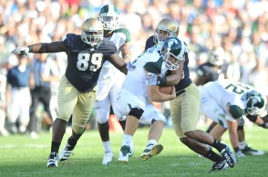 Midway through 2010, Notre Dame switched to adidas' tighter TechFit jerseys. Kapron Lewis-Moore and Robert Blanton are pictured against Michigan State in 2011.