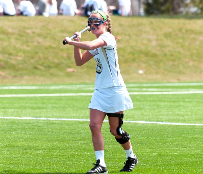 Irish senior attack Lindsay Powell looks to pass during Notre Dame's 13-12 win over Georgetown last season on April 14.