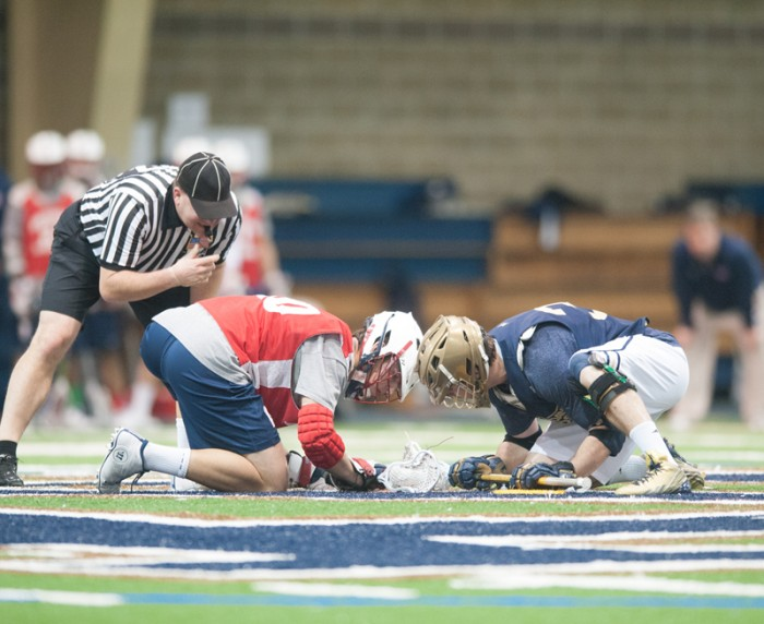 Irish senior midfielder Liam O'Connor takes a faceoff during Notre Dame's 9-7 NCAA first-round victory over Detroit on May 11, 2013.