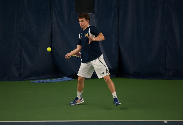 Senior Greg Andrews prepares to hit a forehand in a match against Kenturcky on Sunday. Andrews lost his singles match, but won his doubles match with sophomore Alex Lawson as the Irish defeated the Wildcats 4-3.