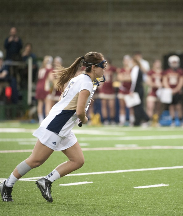 Irish sophomore attack Rachel Sexton races upfield during Notre Dame's 15-10 loss to Boston College on Saturday.
