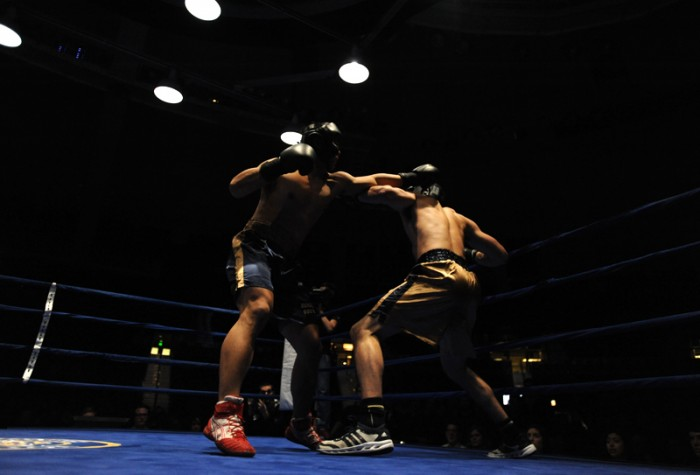 Senior captain Daniel Yi (left) lands a jab to Mike Broghammer's head in the 2013 Bengal Bouts heavyweight final March 1, which Yi won by knock out.