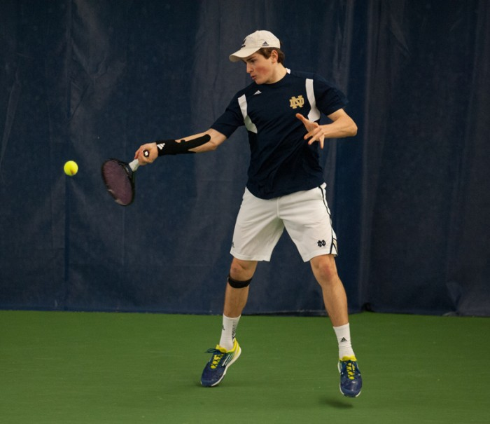 Irish sophomore Eric Schnurrenburger returns the ball during Notre Dame's victory over Kentucky on Feb. 2. Through Schnurrenburger lost both his matches, the Irish still managed to beat the WIldcats 4-3.