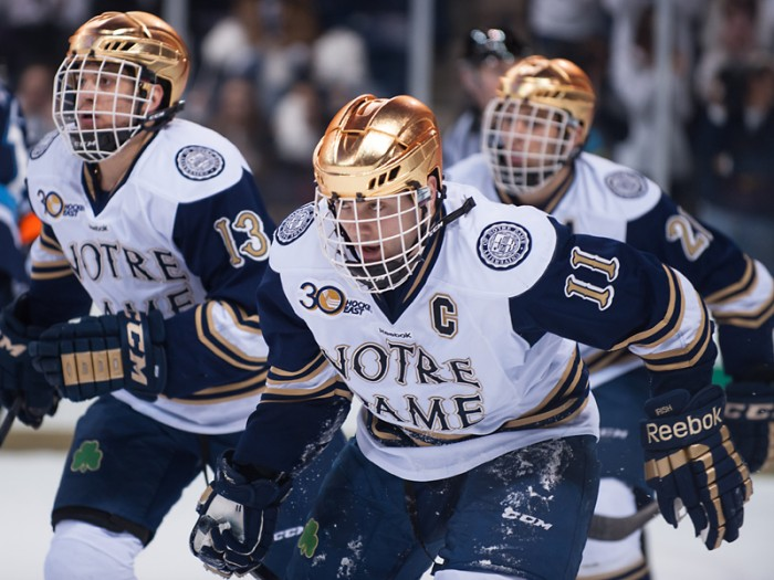 Irish senior left wing Jeff Costello skates ahead in Notre Dame's 2-1 loss to Maine on Feb. 2. The captain scored a goal against Boston University on Saturday.