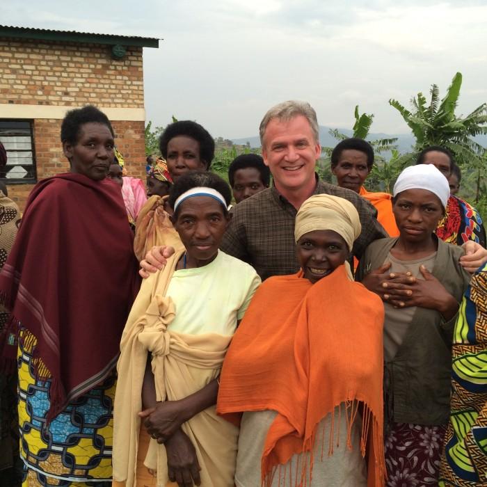 Fr. Dan Groody stands with survivors of the 1994 Rwandan genocide in December. While in Rwanda, Groody visited victims' memorials and met with community leaders seeking to rebuild their country.