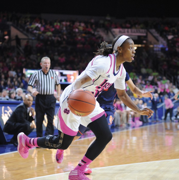 Irish sophomore guard Jewell Loyd dribbles the ball during Notre Dame's 101-64 win over Syracuse in the Purcell Pavilion on Feb. 9.