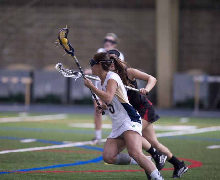 Irish sophomore attack Rachel Sexton evades a defender during Notre Dame's 25-1 victory over Cincinnati on Wednesday.