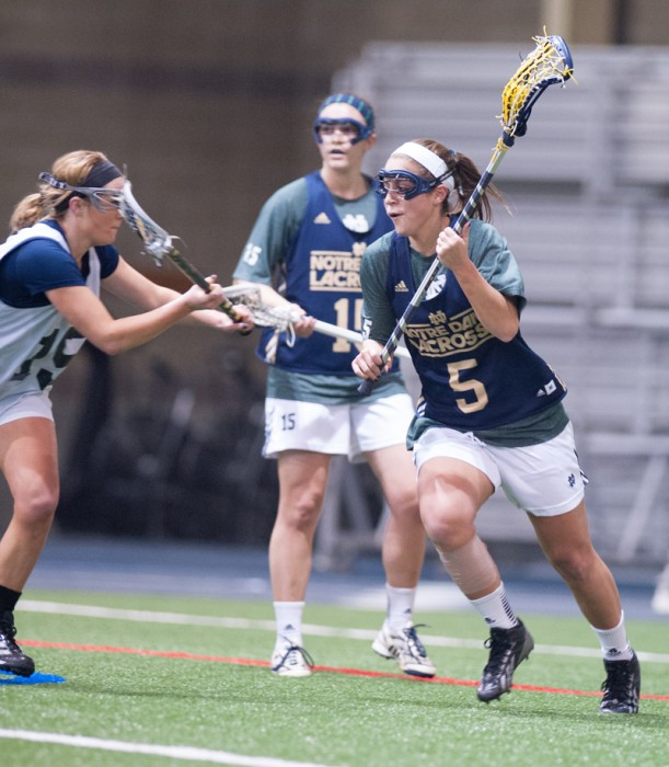 Irish sophomore attacker Rachel Sexton, 5, carries the ball during Notre Dame's 19-7 home win over Michigan in exhibition play Feb. 8.