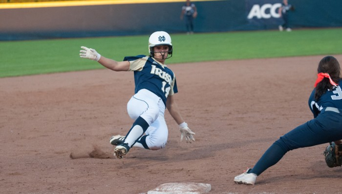 Senior outfielder Monica Torres slides into third base before the tag during a game on Oct. 9. Torres scored a run during Notre Dame's 9-5 win over Virginia Tech on Sunday.