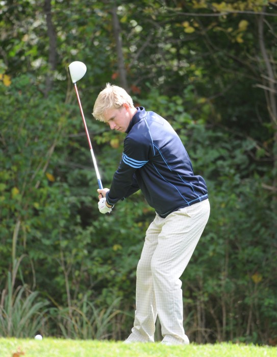 Junior Patrick Grahek tees off at the Fighting Irish Gridiron Golf  Classic at the Warren Golf Course on Oct. 9, 2012.