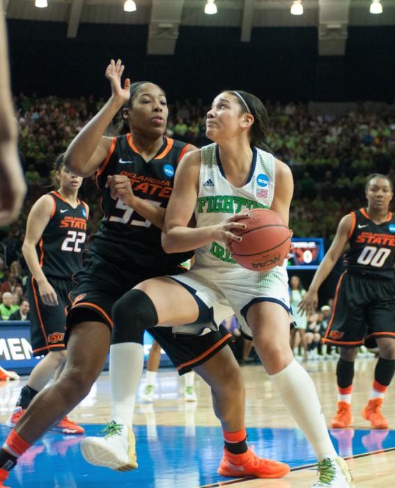 Irish senior forward Natalie Achonwa drives towards the net.