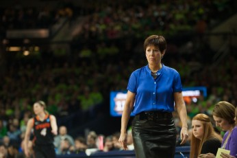 Irish coach Muffet McGraw walks alongside the court.