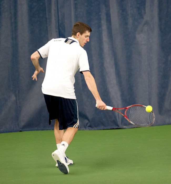 Senior Ryan Bandy reaches for a backhand during a Feb. 28 match against Virginia Tech sophomore Joao Monteiro in Eck Tennis Pavilion. Bandy lost the match, 4-6, 6-1, 6-4.