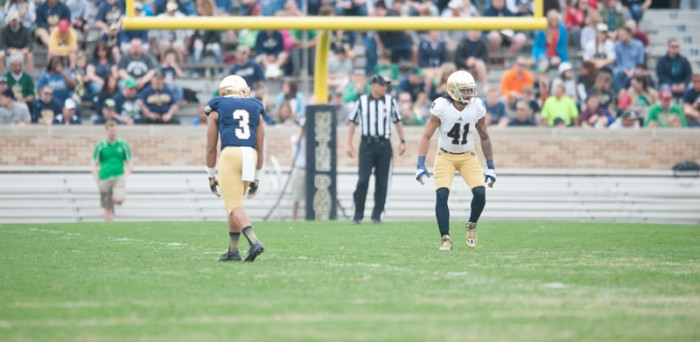 Senior receiver Amir Carlisle, left, lines up against senior cornerback Matthias Farley during the Blue-Gold Game on Saturday. With the announcement that a synthetic playing surface will be installed before the 2014 season, the spring game was the last time the Irish will play on a natural grass field at Notre Dame Stadium.